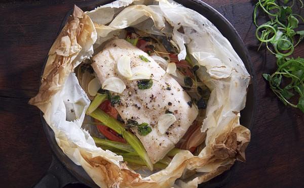 Corvina Papillote una exquicita mezcla de mariscos y pescado